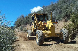 County grader applying outsloping to reduce sedimentation