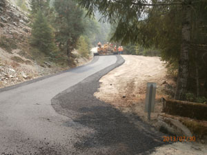 Del Norte County Road Crew apply paving to regraded road to prevent sediments from entering creek on Old Gasquet Toll Road
